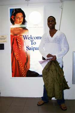 Walt in Saipan. Posing in front of Welcome to Saipan poster at Saipan airport