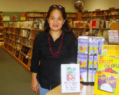 riza ramos and her book, the boy who dreamed to be with his parents on saipan at bestseller books on saipan